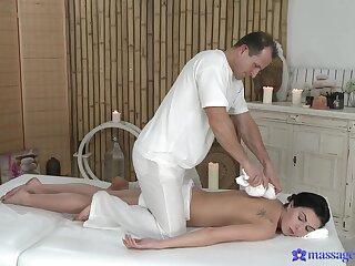 Stony-broke brunette wants the masseur's cock shortly