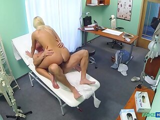 Horny busty tow-headed receives a creampie from the doctor