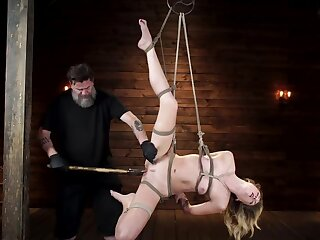 Bearded master stretches hanged girl's pussy using different toys
