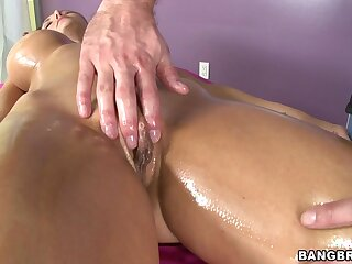 Hot ass model Ava Addams sucks a Hawkshaw while being massaged